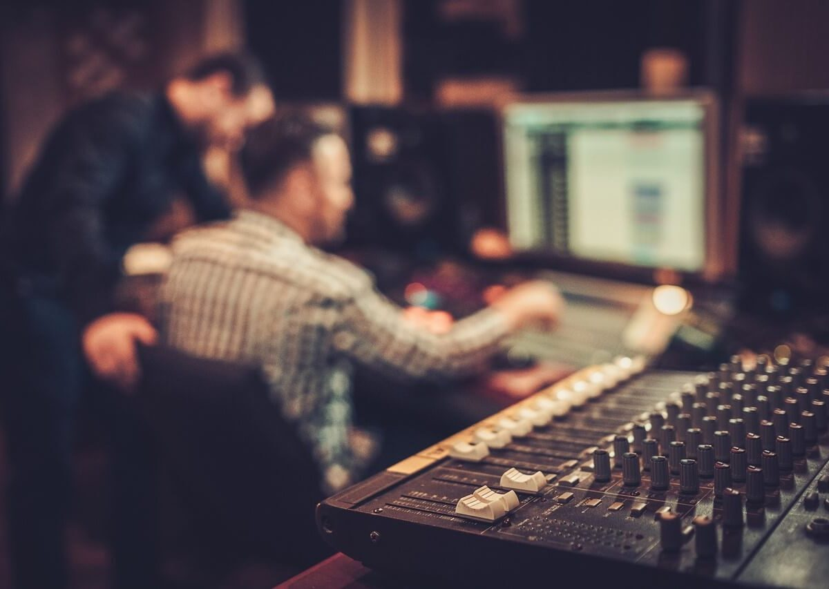 bigstock-Sound-engineer-and-producer-wo-117327860